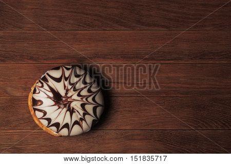 black and white bun on dark wooden background