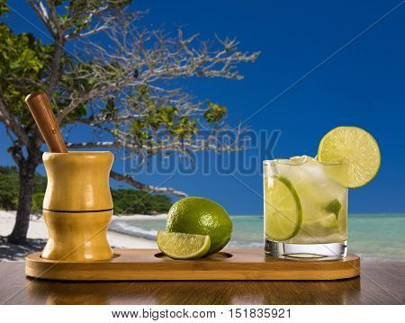Lemon Fruit Caipirinha Of Brazil Over Beautiful Beach Background