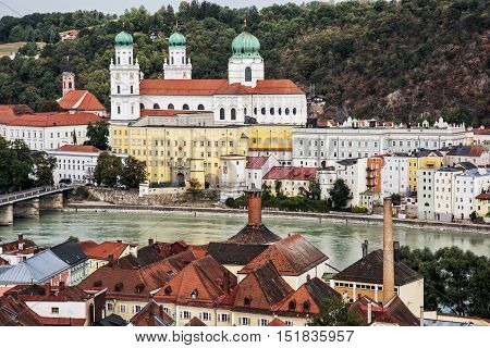 Saint Stephen's cathedral Passau city Germany. City panorama. Largest church pipe organ. Urban scene. Red roofs and river. Cultural heritage.
