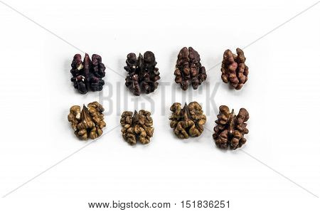 Walnuts arranged on white background. Top view.