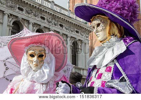 VENICE, ITALY - FEBRUARY 15, 2015: Two unidentified persons wearing traditional costumes and posing during the Carnival of Venice