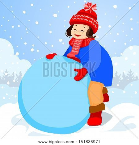 Girl sculpts a large clump of snow. She will make a snowman. It is snowing outside. On the girl a red cap and blue coat.