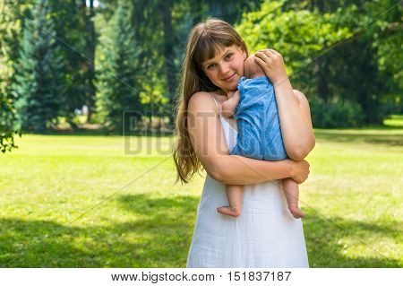Beautiful Mother And Her Baby Playing In Park