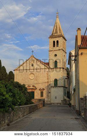 ZLARIN, CHROATIA - SEPTEMBER 12, 2016: It is the parish church of the Assumption on the island of Zlarin.