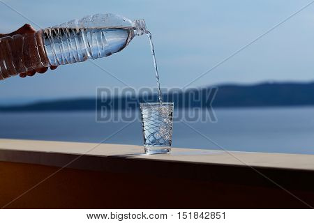 Female Hand Pours Water