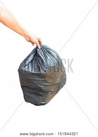 Asian Hand Carrying Garbage Bag Over Pile Of Garbage Bags In A Dump