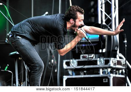 MOSCOW RUSSIA - JULY 31 2010: British singer Tom Smith from Editors during performance at Moscow rock festival in Moscow Russia