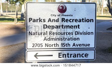PHOENIX AZ - DECEMBER 25 2013: City of Phoenix Parks and Recreation Department sign in Encanto Park that points to a building of Natural Resources Division Administration entrance.
