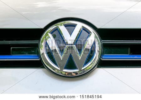 TURIN, ITALY - JUNE 9, 2016: Volkswagen logo on the hood of a white car