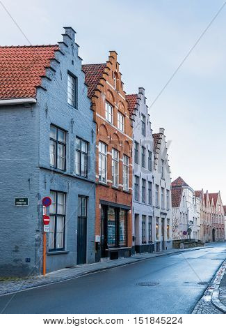 Brugge (Bruges) - February 2016, Belgium: Street view with traditional brick houses in one of the most popular touristic Belgian city