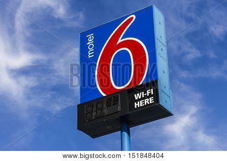 Kokomo - Circa October 2016: Motel 6 Logo and Signage. Motel 6 is a major chain of budget motels II