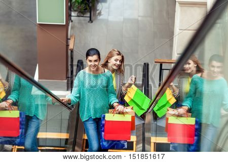 Women on the moving staircase