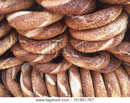 Simit that is a traditional Turkish fast food. The bakery bagel which encrusted with sesame seeds.