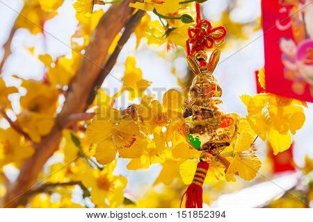 Golden hare chinese New Year decoration. Symbols of luck and protection. Cambodia.