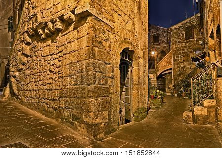 Pitigliano, Grosseto, Tuscany, Italy: picturesque old alley at night in the medieval town founded in Etruscan time.