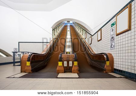at the station have several wooden escalators for each peron