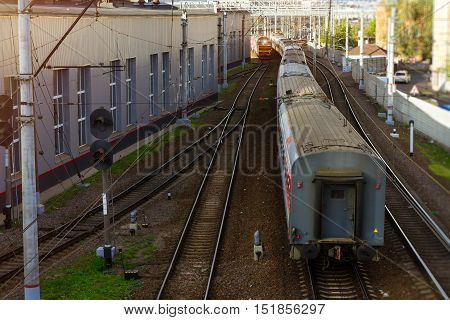 Last rail car. Electric locomotive pulling high-speed train on rails. Technical railway station - operational locomotive depot. Transport infrastructure of Russian Railways Saint-Petersburg