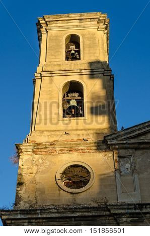 Ancient bell tower in sunlight of Parroquia Sant Joan Baptista in Tarragona, Spain