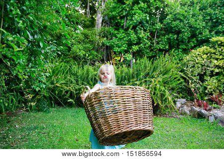 Little Girl Carrying Big Empty Laundry Basket