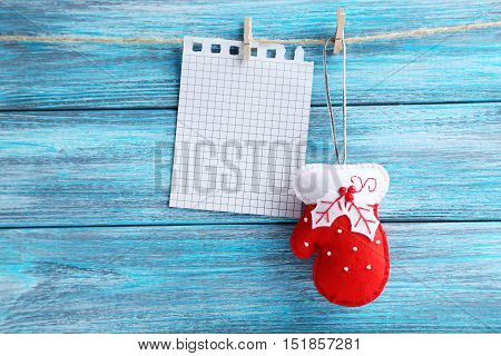 Christmas Decoration Hanging With Blank Sheet Of Paper On Rope On Wooden Background