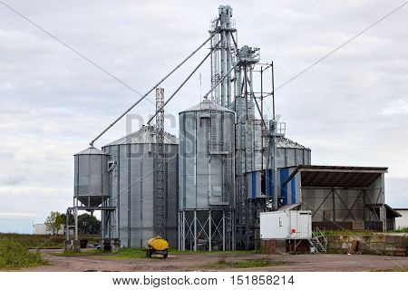 Building Exterior of Agricultural Silo with storage tanks cultivated agricultural crops processing plant drying of grains wheat corn soy sunflower.