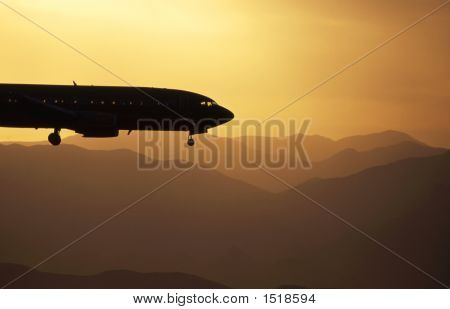 Jet Landing At Sunset