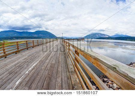 HDR rendering of Salmon Arm wharf on a cloudy morning. The wharf is the longest wooden wharf in North America.