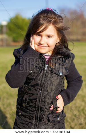 7 year old girl outside in a jacket