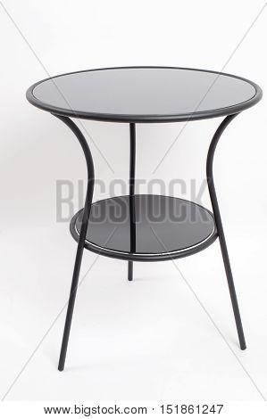 Modern Glass tablethree legged on isolated , interior