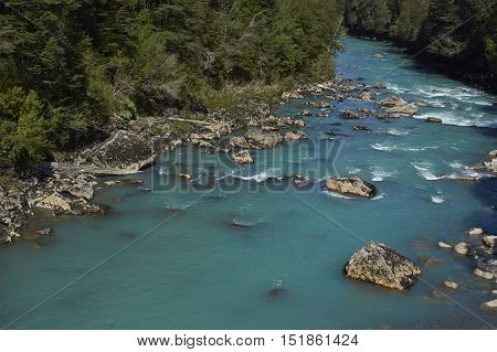 Clear blue waters of the Rio Frio on the Carretera Austral road in the Aysen Region of southern Chile.