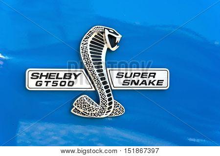 TURIN, ITALY - JUNE 9, 2016: Cobra Shelby logo on a blue car body