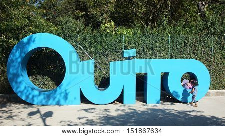 Quito, Pichincha / Ecuador - October 15 2016: Girls playing in giant letters forming the word QUITO in the La Carolina Park in the north of the city of Quito