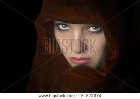 Beautiful Image of a woman In a red cape