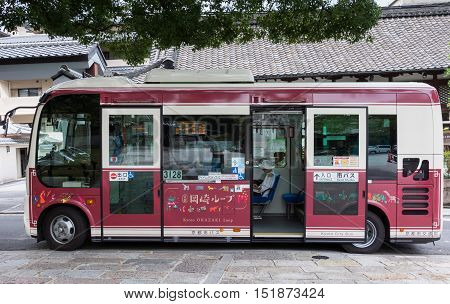 Kyoto Japan - September 16 2016: One of the many Kyoto City Bus vehicles. Wine-colored smaller bus with large windows.