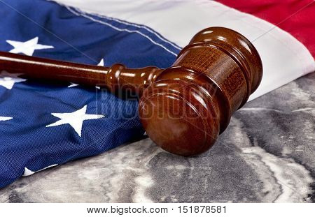 Wooden gavel on top of American flag with room for your type.