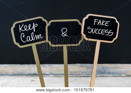 Keep Calm And Fake Success Message Written With Chalk On Mini Blackboard Labels