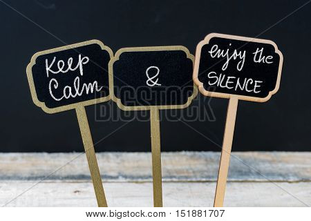 Keep Calm And Enjoy The Silence Message Written With Chalk On Mini Blackboard Labels