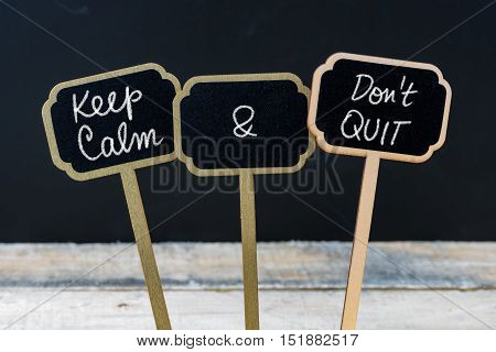 Keep Calm And Do Not Quit Message Written With Chalk On Mini Blackboard Labels