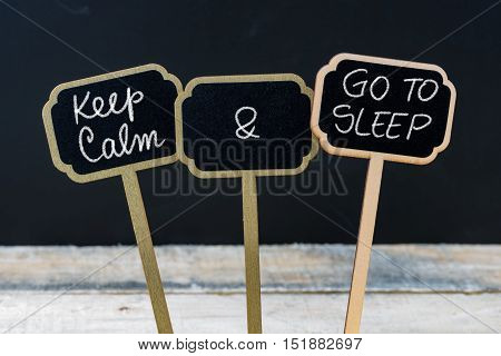 Keep Calm And Go To Sleep Message Written With Chalk On Mini Blackboard Labels