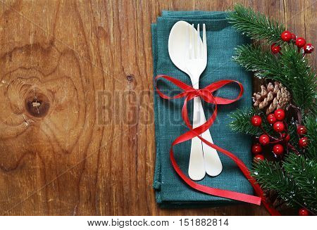 cutlery fork and spoon Christmas table setting on wooden background