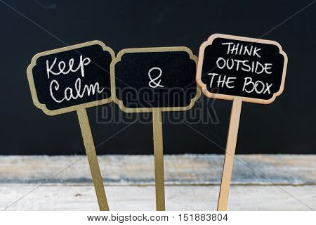 Keep Calm And Think Outside The Box Message Written With Chalk On Mini Blackboard Labels