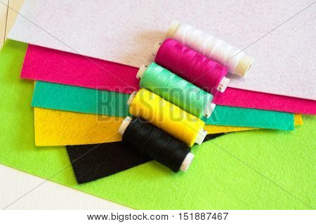 Set of colored felts and threads. Sewing kit