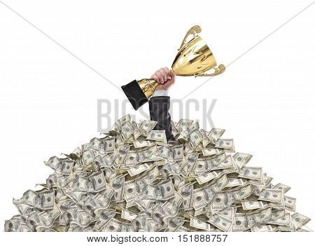 hand of a man stuck in a pile of money holding a cup trophy above the surface
