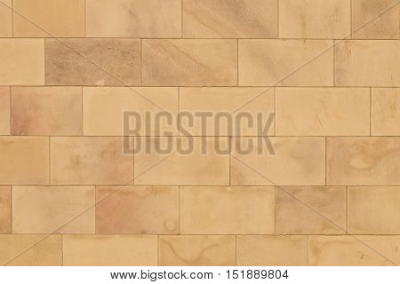 Smooth flat block wall with a warm look to it.