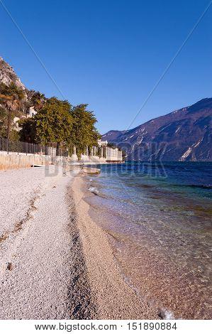 Beach near Limone sul Garda in the Garda Lake (Lago di Garda). Lombardy Veneto Italy Europe