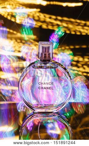 Bangkok, Thailand - November 16, 2014 : Perfume bottle and light painting on the black background.