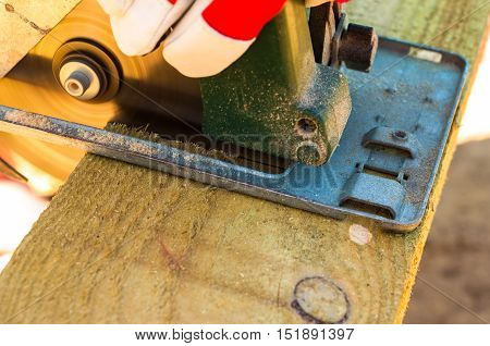 Working with electric saw machine outdoor construction