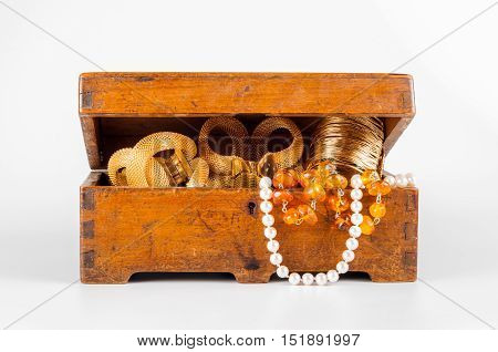 wooden jewelry box with jewelries on white background