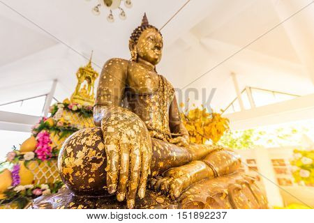 Put Gold Leaf Onto The Buddha Statue To Gild. Which People Use To Worship The Buddha Image.