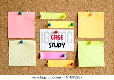 Sticky note on cork board background and text concept